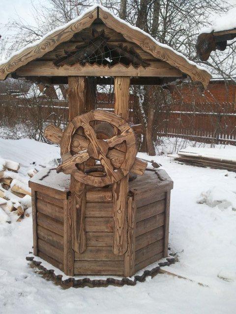оголовок для колодца из состаренной древесины с ковкой.