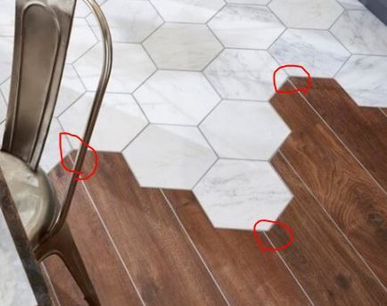 Одинаковая плитка на полу на кухне, в санузлах и в коридоре