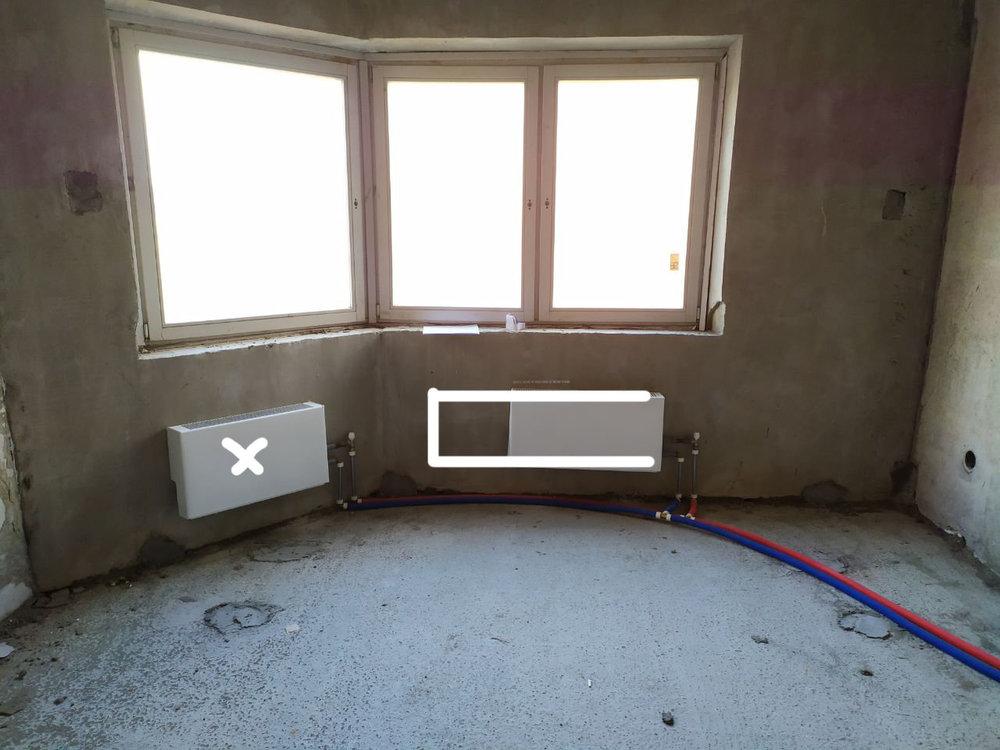 Стоит ли послушать ремонтников и вместо двух радиаторов, сделать один под большим окном?